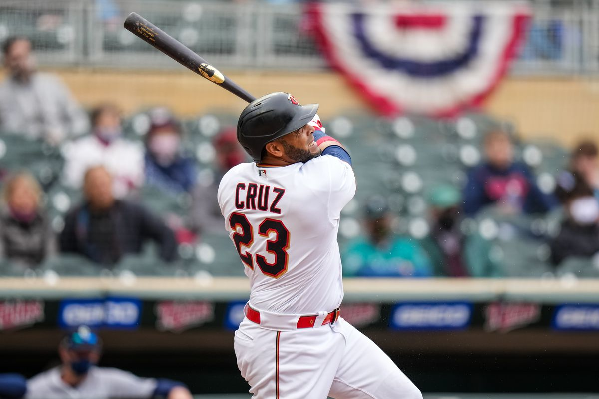 Nelson Cruz #23 of the Minnesota Twins bats against the Seattle Mariners on April 11, 2021 at Target Field in Minneapolis, Minnesota.