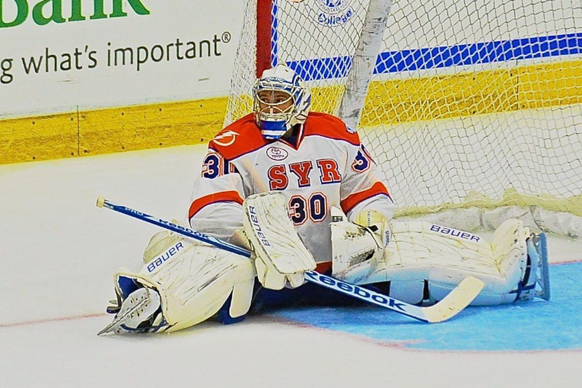 Syracuse Crunch goalie Cedrick Desjardins (30) after being scored upon by the Binghamton Senators in American Hockey League (AHL) action at the Onondaga County War Memorial on Friday, October 18, 2013. Binghamton won 6-2.