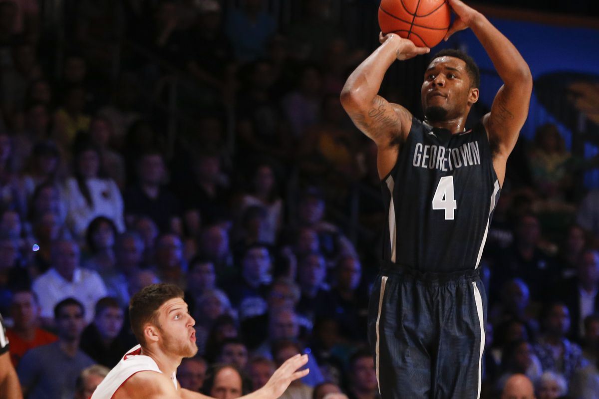 Georgetown guard D'Vauntes Smith-Rivera elevates for a shot over Zak Showalter in the Bahamas.