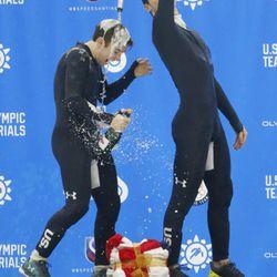 John-Henry Krueger, right, celebrates with Ryan Pivirotto, left, on the podium following the U.S.Olympic short track speedskating trials Sunday, Dec. 17, 2017, in Kearns, Utah. (AP Photo/Rick Bowmer)