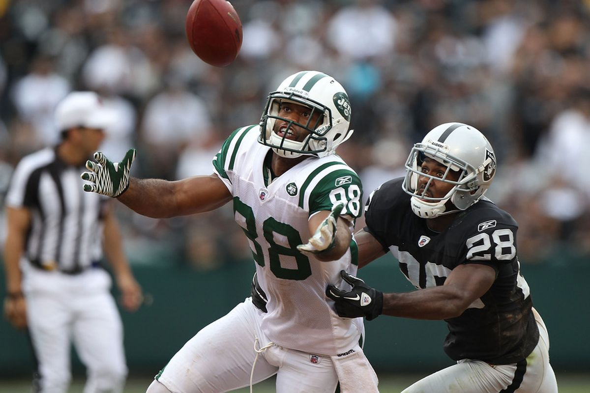 OAKLAND, CA - SEPTEMBER 25:  Patrick Turner #88 of the New York Jets misses a pass as Joe Porter #28 of the Oakland Raiders defends at O.co Coliseum on September 25, 2011 in Oakland, California.  (Photo by Jed Jacobsohn/Getty Images)