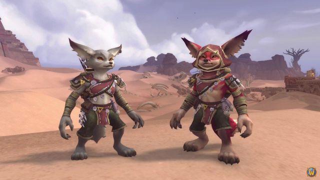Two Vulpera standing in a desert