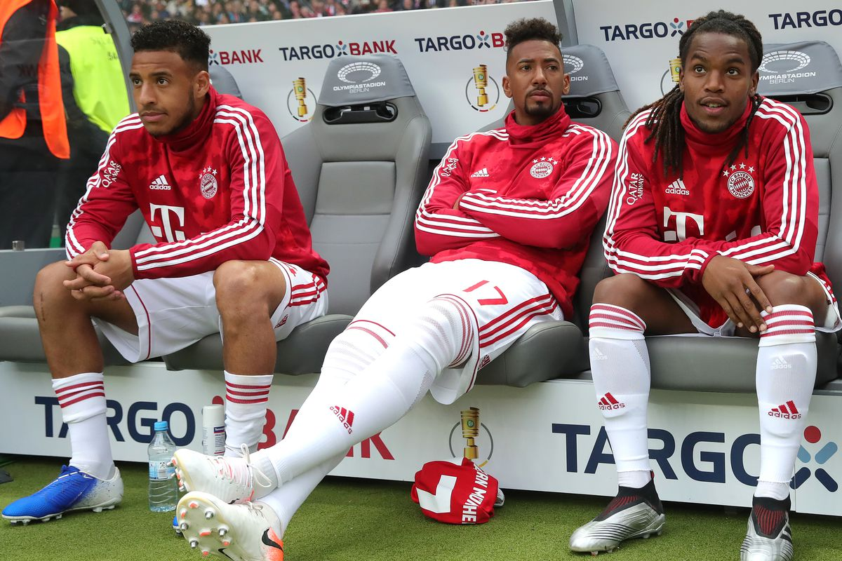 BERLIN, GERMANY - MAY 25: Jerome Boateng (2nd R) of Bayern Muenchen take place on the team beanch for the DFB Cup final between RB Leipzig and Bayern Muenchen at Olympiastadion on May 25, 2019 in Berlin, Germany.