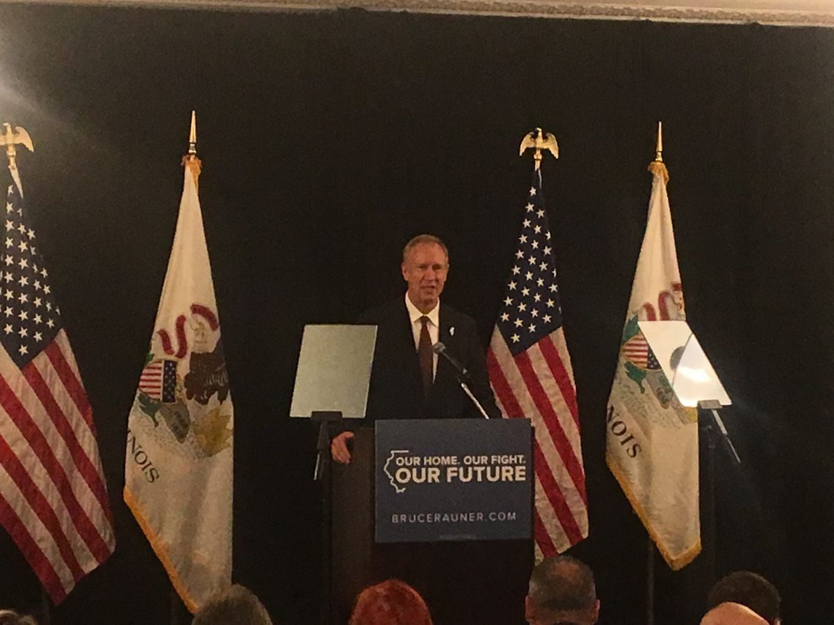 Gov. Bruce Rauner delivers a 25-minute speech at the Hilton Chicago to a closed room of lawmakers and invited guests. Photo by Tina Sfondeles.