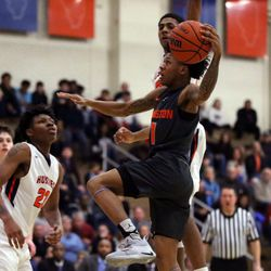 Evanston's Jaheim Holden (1) drives in for a layup against Oak Park during their 79-69 win in Oak Park,  Saturday, February 2, 2019. | Kevin Tanaka/For the Sun Times