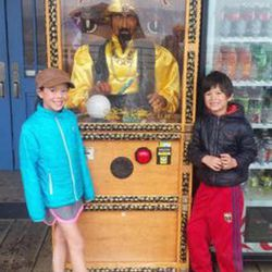 Posing for a photo with Zoltar, the fortune teller.