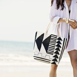 The best part of this cool, geometric printed tote? It's spill and sand proof.