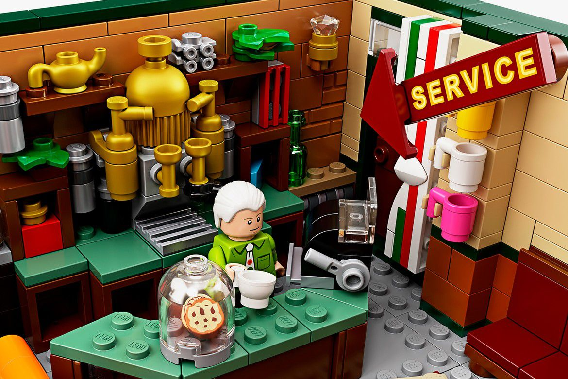 Man behind the counter in a Lego coffee shop.