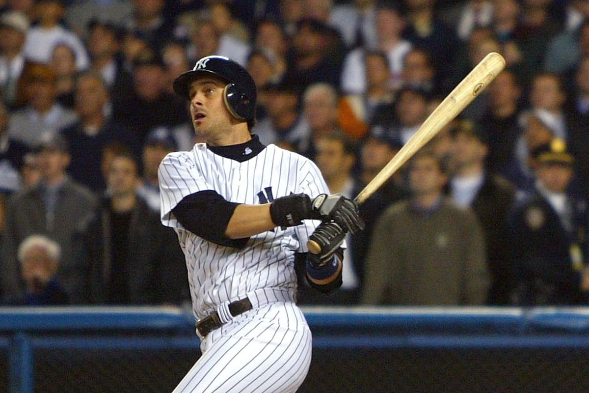 Aaron Boone hits the game winning home run in the bottom of the eleventh inning against the Boston Red Sox during Game Seven of the American League Championship Series on October 16, 2003 at Yankee Stadium.