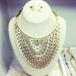 Another favorite, the Sierra bib necklace features 12k gold-finished brass discs.
