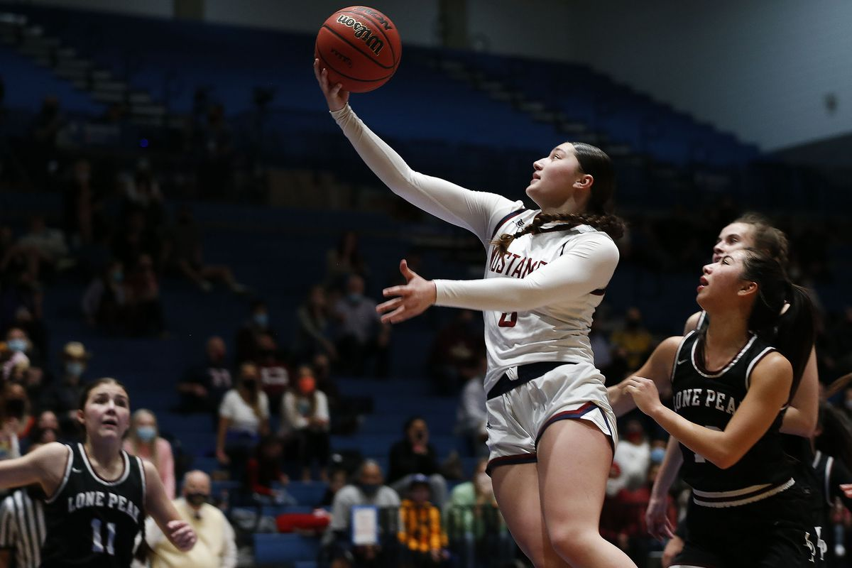 Herriman's Lealani Falatea shoots against Lone Peak during the 6A girls basketball state semifinals at Salt Lake Community College in Salt Lake City on Thursday, March 4, 2021.Herriman won 54-46.