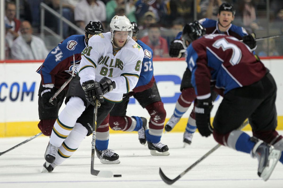 DENVER - SEPTEMBER 28:  Tomas Vincour #81 of the Dallas Stars controls the puck against the Colorado Avalanche during preseason NHL action at the Pepsi Center on September 28 2010 in Denver Colorado.  (Photo by Doug Pensinger/Getty Images)