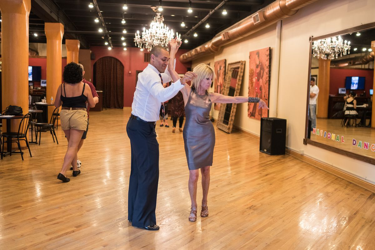 Sandy Mandel dances with instructor Drew Sutherland at Arthur Murray studio in River North on July 18, 2017. | Max Herman/For the Sun-Times