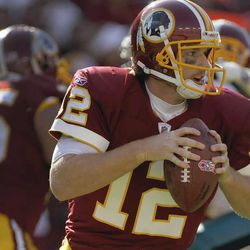 Washington Redskins quarterback John Beck scrabbles with the football during the second half of an NFL football game against Philadelphia Eagles in Landover, Md. Sunday, Oct. 16, 2011. (AP Photo/Pablo Martinez Monsivais)