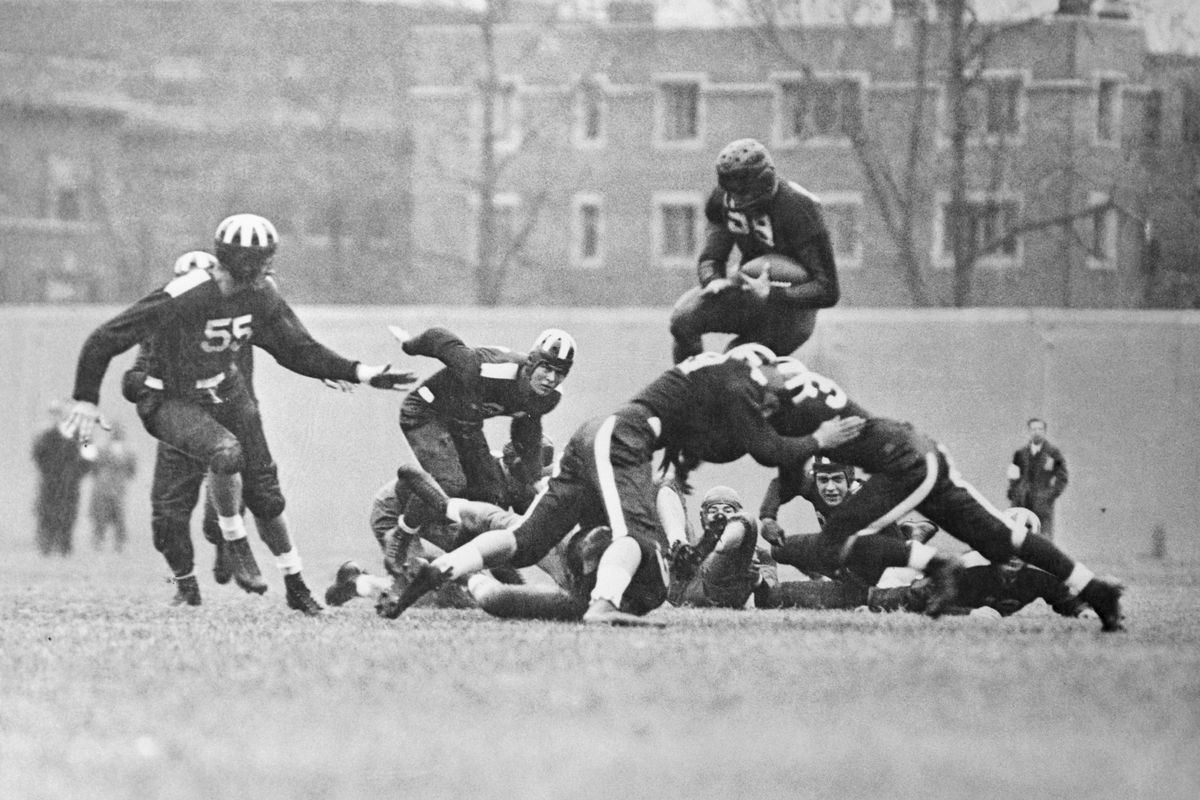 Jay Berwanger and Others Playing Football