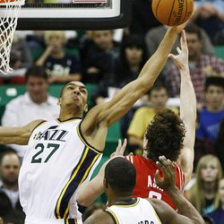 Utah Jazz's center Rudy Gobert (27) blocks the shot of Houston's Omer Asik as the Jazz and the Rockets play Saturday, Nov. 2, 2013 in EnergySolutions arena.