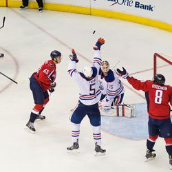 Fayne and Ovechkin Reach For Puck
