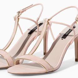 """<b>Zara</b> High Heel Sandal With Edging in Nude, <a href=""""http://www.zara.com/us/en/woman/shoes/heeled-sandals/high-heel-sandal-with-edging-c358014p1953043.html"""">$60</a>"""