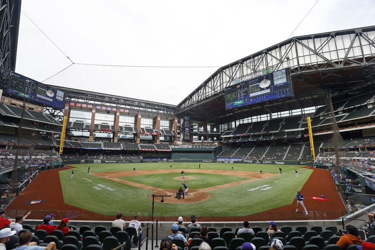 The Texas Rangers and the Milwaukee Brewers play a preseason baseball game at Globe Life Field, Tuesday, March 30, 2021, in Arlington, Texas.