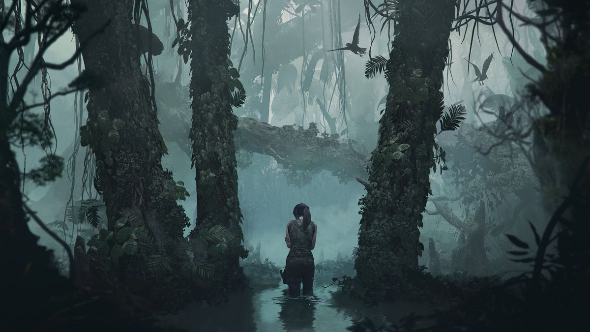 Shadow of the Tomb Raider - Lara wading through a swampy forest