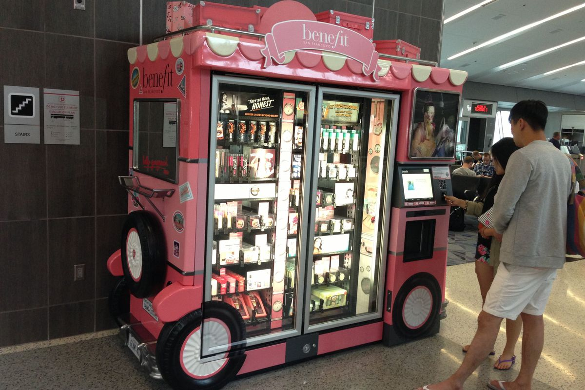 Benefit's Glam Up and Away kiosk in Terminal 3