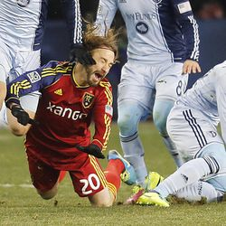 Real's Ned Grabavoy gets taken down by Kansas City's Benny Feilhaber as Real Salt Lake and Sporting KC play Saturday, Dec. 7, 2013 in MLS Cup action. Sporting KC won in a shootout.