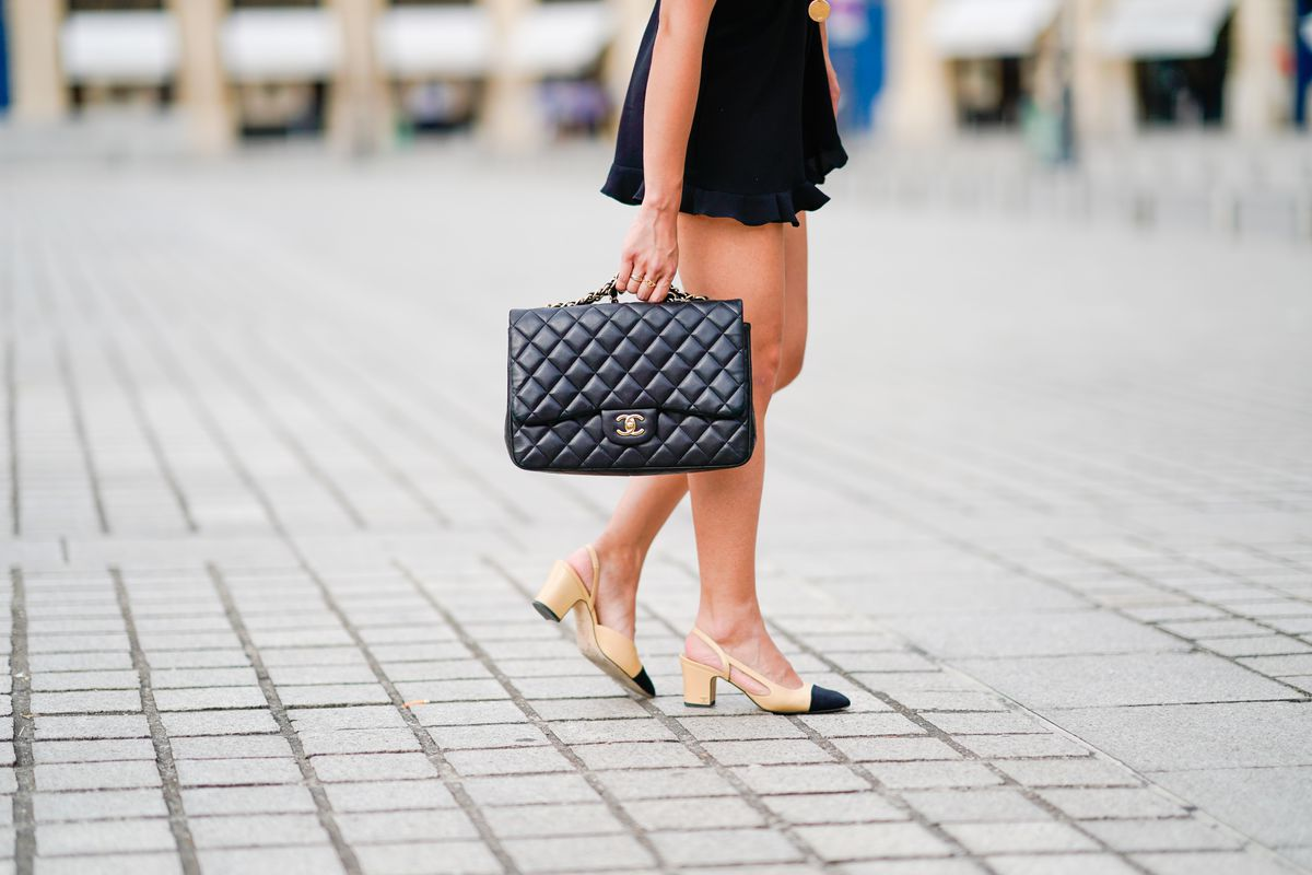 c35e711169bd26 Knockoffs of Chanel's quilted bags and two-tone slingbacks can be found in  stores the world over. Edward Berthelot/Getty Images