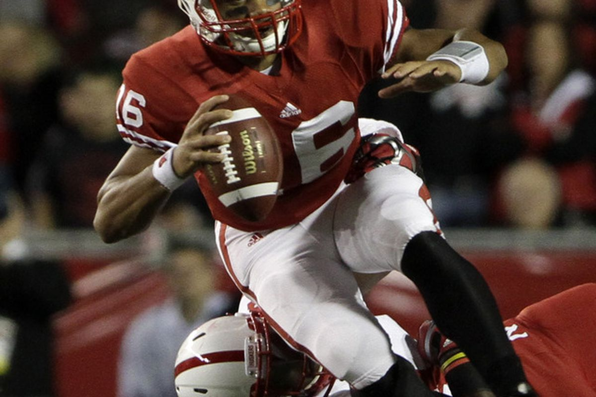 One of the few times the Huskers got Russell Wilson contained in the first half.  Need much more of that in the second half.  (Photo by John Gress/Getty Images)
