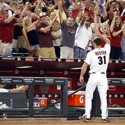 Arizona Diamondbacks' John Hester takes a curtain call after hitting a two-run home run in his first MLB at-bat.