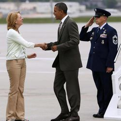 President Barack Obama is greeted by former Iowa Attorney General Bonnie Campbell on the tarmac upon his arrival at Des Moines International Airport, Saturday, Sept. 1, 2012, in Des Moines, Iowa.
