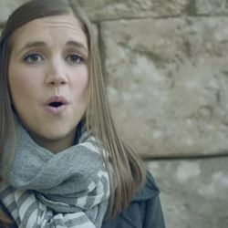 BYU Noteworthy member sings with other members of the two a cappella ensembles.