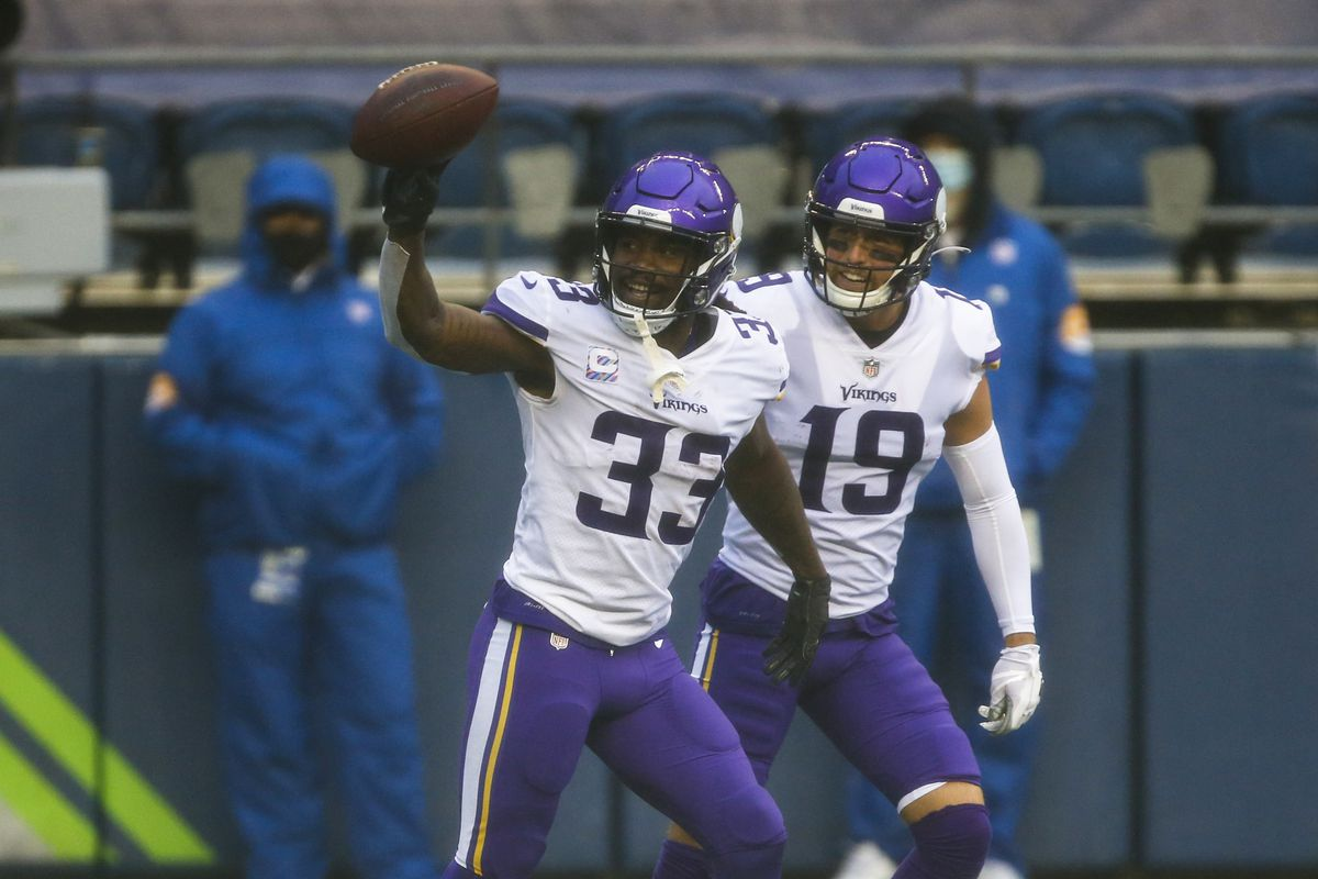 Minnesota Vikings running back Dalvin Cook (33) celebrates with wide receiver Adam Thielen (19) after rushing for a touchdown against the Seattle Seahawks during the first quarter at CenturyLink Field.
