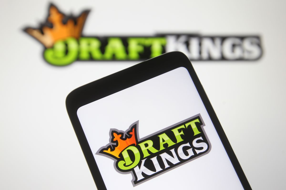 In this photo illustration a DraftKings logo, of the U.S.
