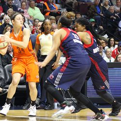 Connecticut Sun's Kelly Faris (34) is double-teamed by Washington Mystics' Tianna Hawkins (21) and Tierra Ruffin-Pratt (14).