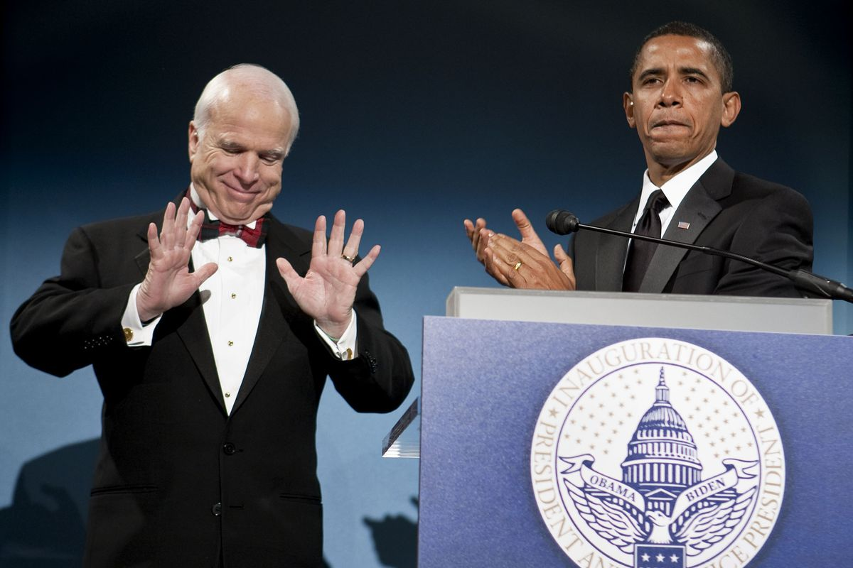 Barack Obama and John McCain together at a bipartisan dinner in Washington, DC in January 2009, ahead of Obama's inauguration.