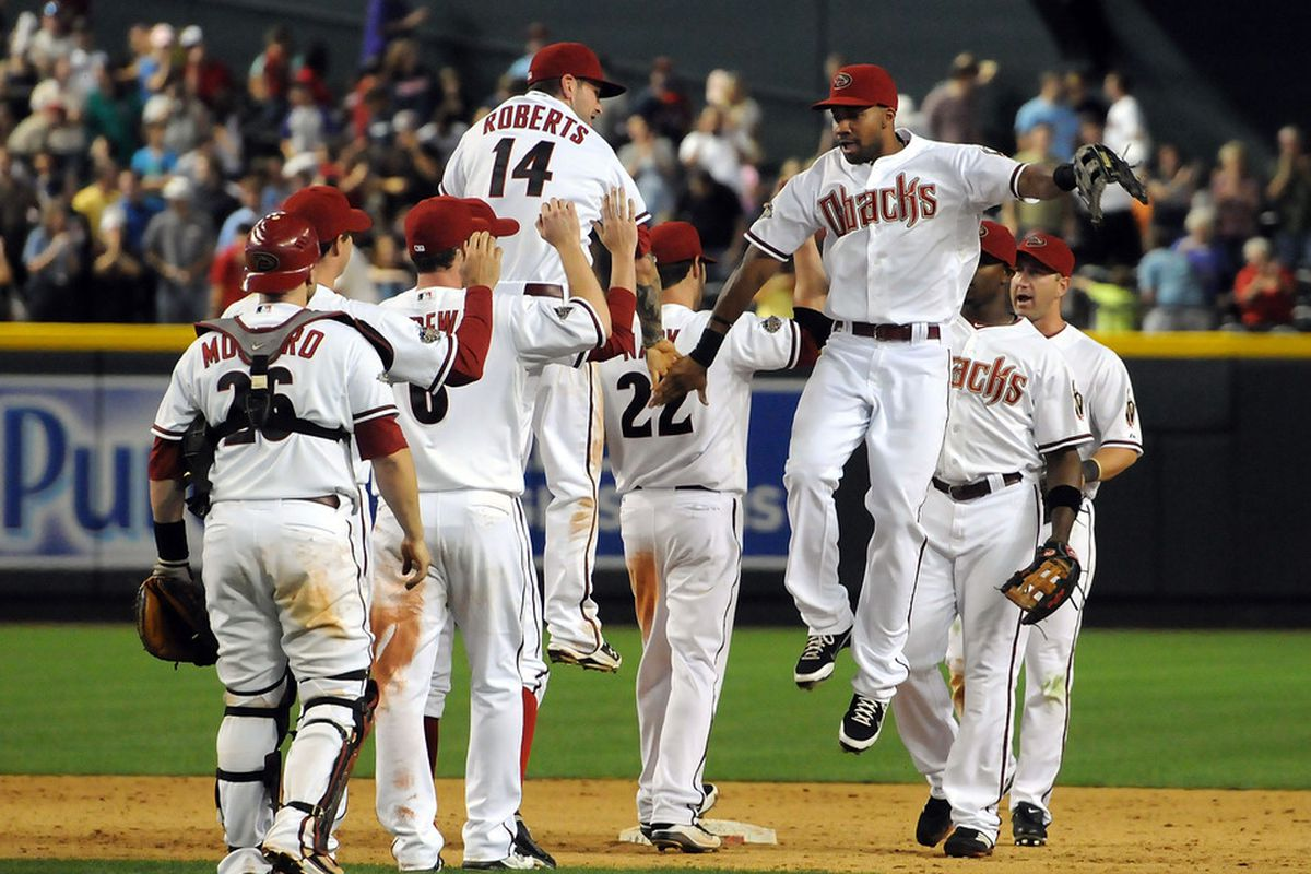 Chris Young #24 of the Arizona Diamondbacks and teammates celebrate a win against the Minnesota Twins at Chase Field in Phoenix, Arizona.  (Photo by Norm Hall/Getty Images)