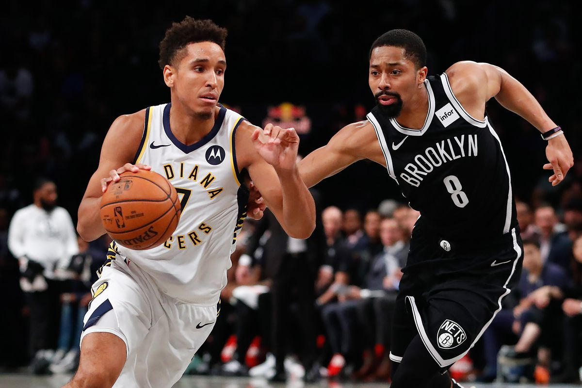Indiana Pacers guard Malcolm Brogdon drives to the basket against Brooklyn Nets guard Spencer Dinwiddie during the first half at Barclays Center.
