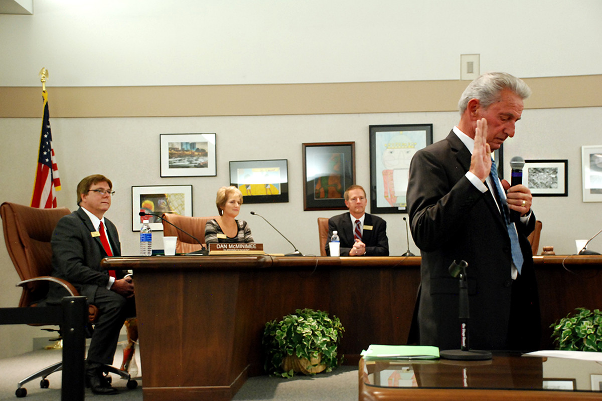 Ron Mitchell, right, takes the oath of office for the Jefferson County school board in 2015.