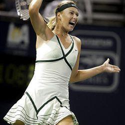 Maria Sharapova, of Russia, returns the ball to Urszula Radwanska, of Poland, during a quarterfinal match.