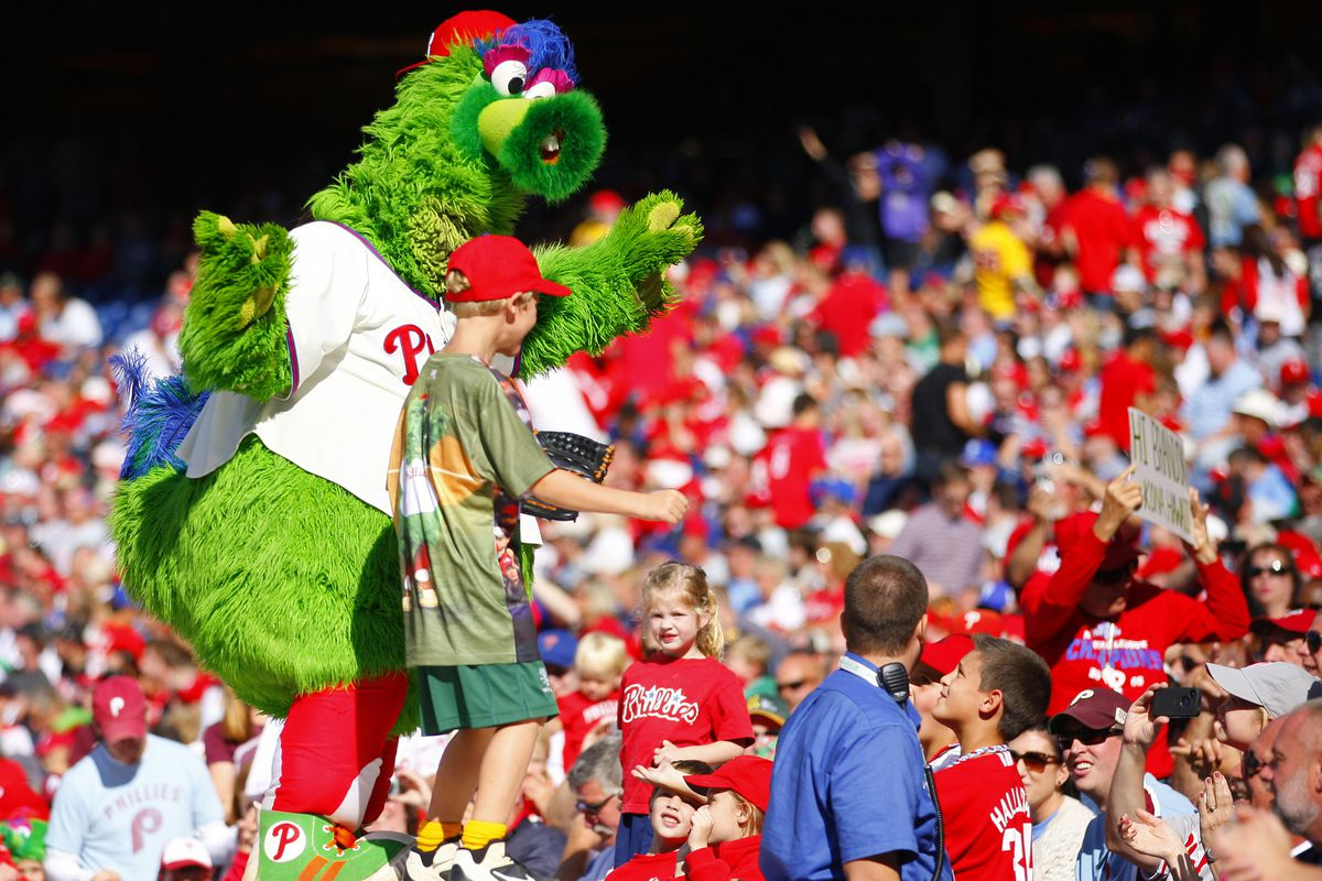 """The Phillie Phanatic adds """"kidnapping"""" and """"hostage-taking"""" to his general buffoonery on Sunday afternoon in Philadelphia. (Photo by Rich Schultz/Getty Images)"""