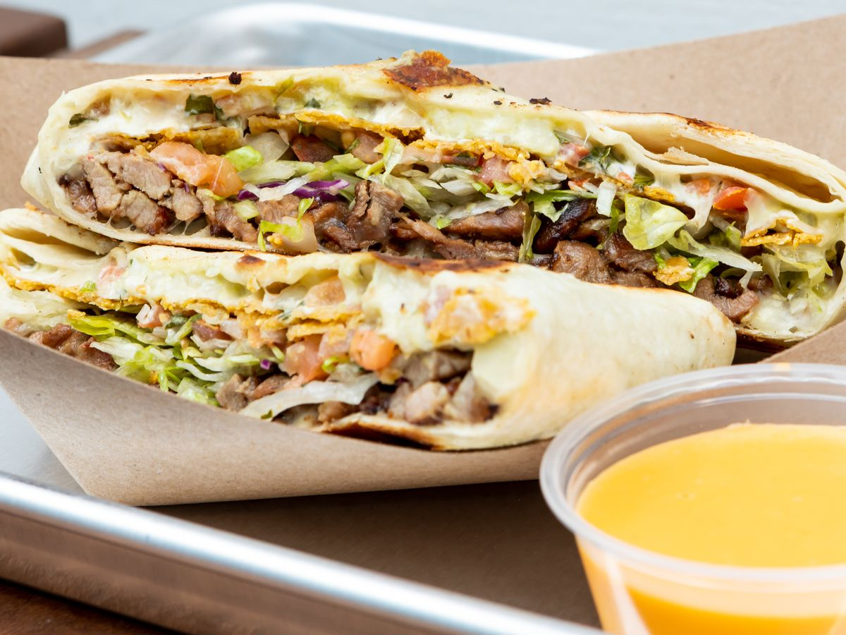 The Sisig Crunchwrap at Señor Sisig, with cheese dip on the side