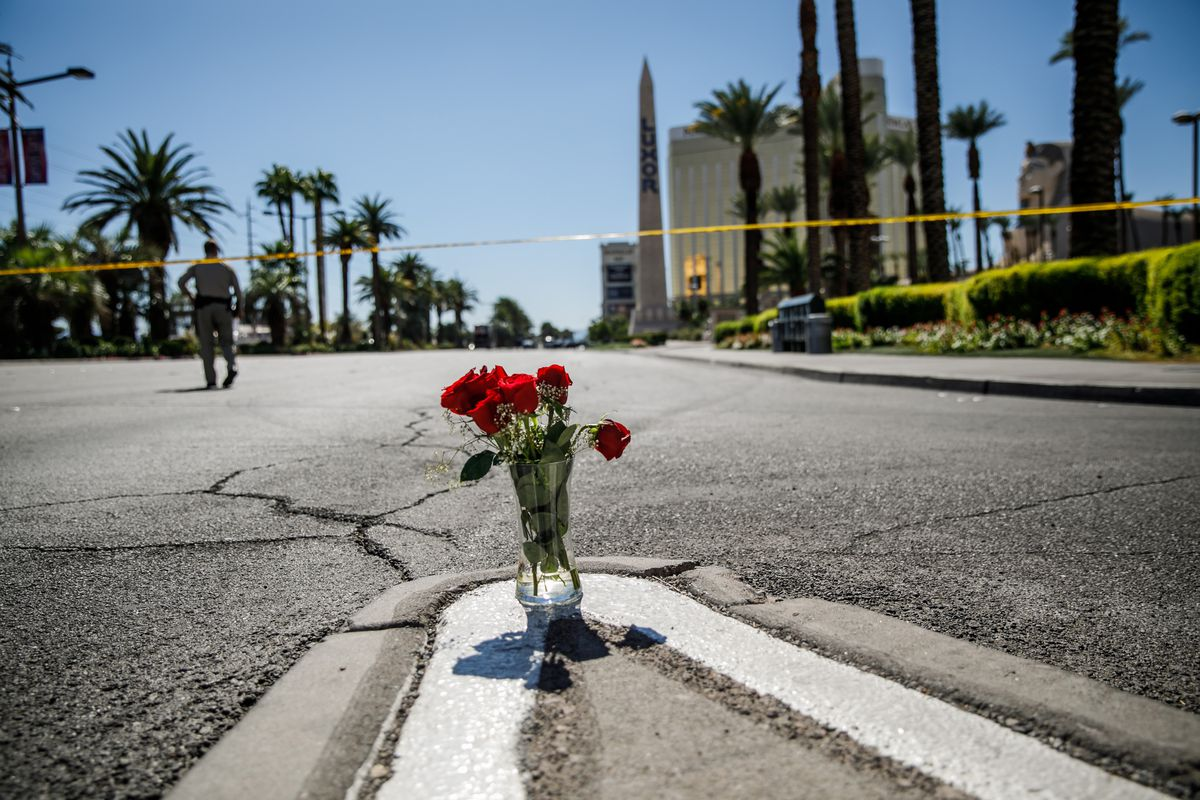 A makeshift memorial — a vase of roses — placed on a traffic island on Las Vegas Blvd., near the site of the shooting.
