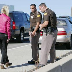Trooper Mike Singleton, center, conducts a roadside sobriety test Wednesday, Oct. 17, 2012, on a female driver on Bangerter Highway near 1300 South. Trooper Ben Fallows stands at right. The woman was arrested for investigation of drunken driving.
