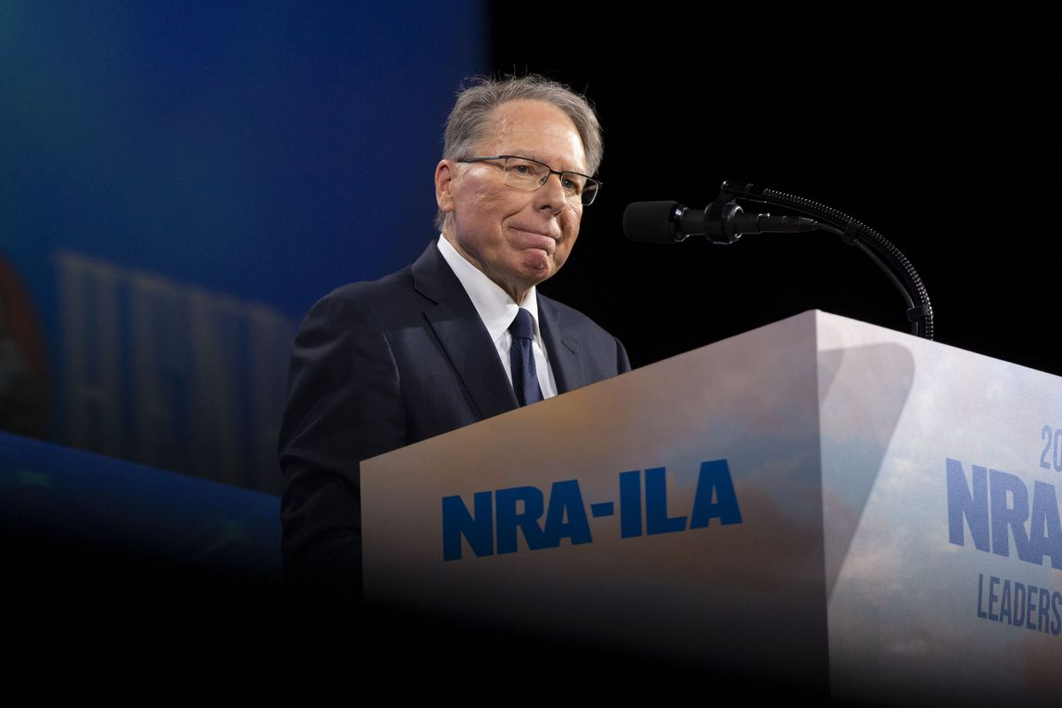 Wayne LaPierre, the CEO and executive vice president of the NRA, standing onstage at a lectern.