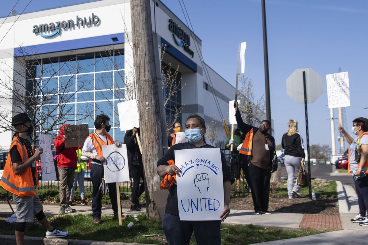 About a dozen Amazon workers stage a walkout and protest at the online retailer's Gage Park facility on Wednesday, April 7, 2021 to demand better working conditions.