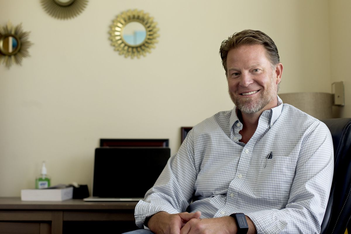 Dr. Rob Butters, Ph.D, LCSW, sits in his office in West Valley City on Wednesday, July 18, 2018.