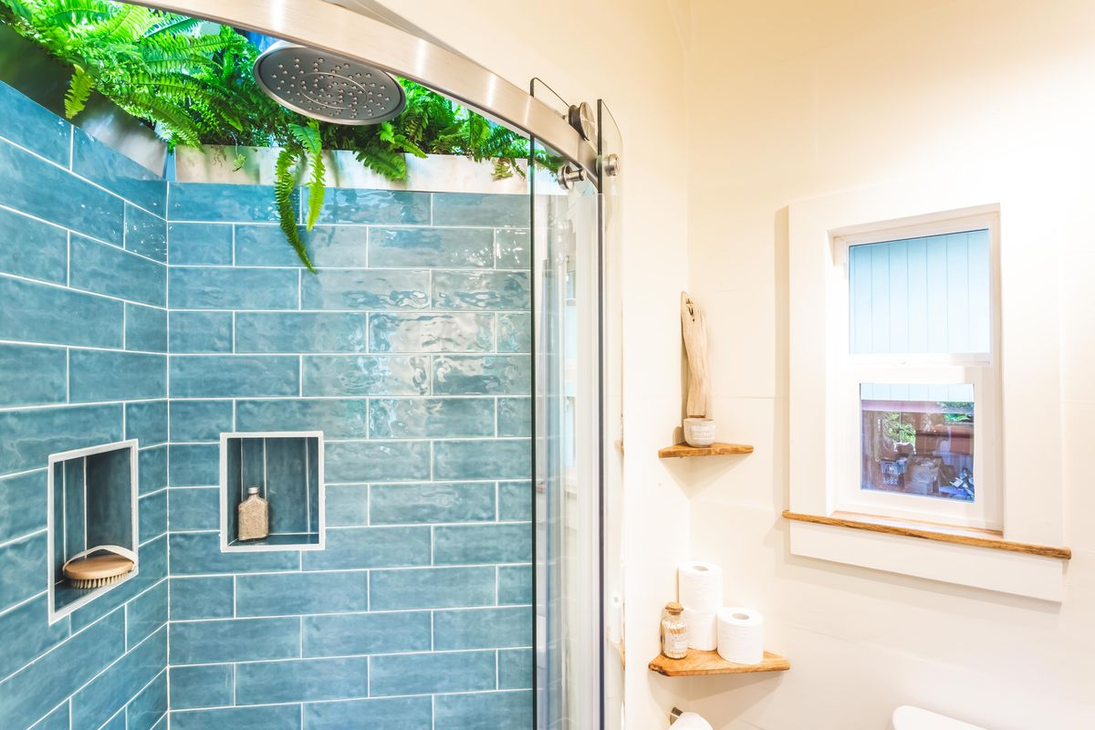 Bathroom with blue tile in the shower.