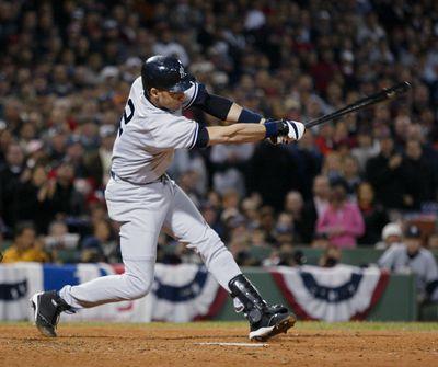 New York Yankees' Derek Jeter doubles in three runs in the s