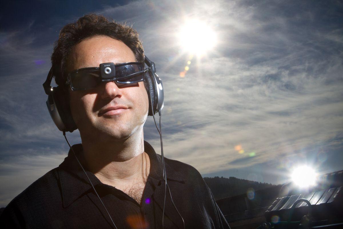 Neuroscientist Amir Amedi, wearing a device setup that translates images into music