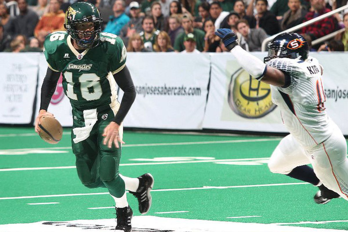 No. 16 Mark Grieb of the San Jose SaberCats rolls out and looks to pass against the Spokane Shock on March 11, 2011. Photo courtesy of the San Jose SaberCats, via Aric Crabb.
